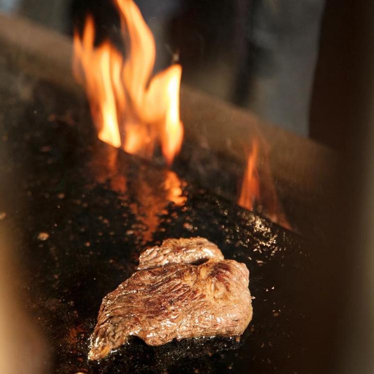temper steak being grilled